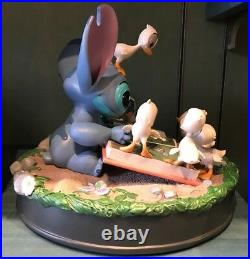 Disney parks stitch and ducklings medium figure new in box